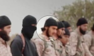 The man standing to the right of a jihadi featured in Isis beheading video is alleged to be Nasser Muthana