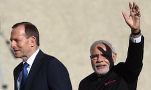 Narendra Modi  waves to supporters as he walks with Tony Abbott after receiving a ceremonial welcome at Parliament House.