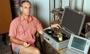Dr Philip Nitschke in his office in June 1996 with his euthanasia delivery system, which comprised a lap-top computer and a box containing a syringe which was connected to the patient by intravenous line and driven by compressed air. The equipment was labelled 'The Death Machine'.  Dr Nitschke assisted in the second legal suicide in Darwin on 2 January 1997, of Janet Mills, 52, who suffered from terminal skin cancer.