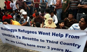 Rohingya refugees hold a banner during a protest outside the United Nations High Commission for Refugees office in Medan, North Sumatra province, Indonesia in 2013.