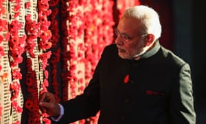 India's prime minister Narendra Modi places a poppy on a wall at the Australian War Memorial in Canberra. on Tuesday.