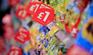 Supermarket shelves with price offers