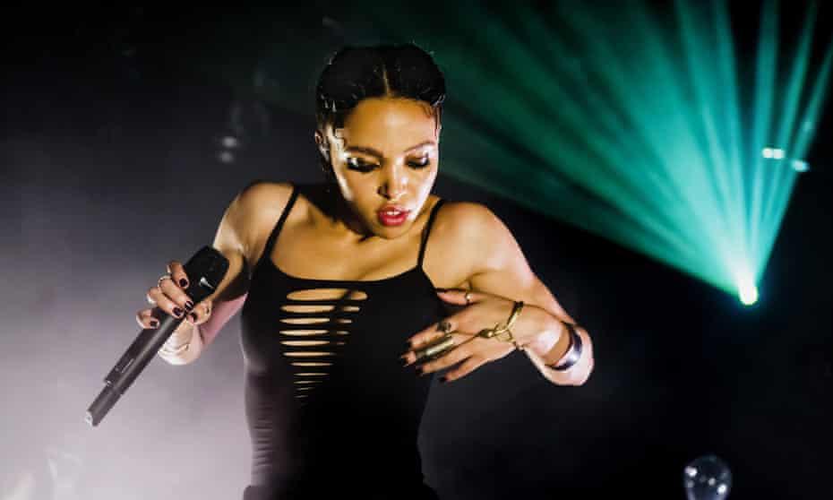 FKA Twigs (Tahliah Debrett Barnett) performs on stage at Tolhuistuin on October 15, 2014 in Amsterdam, Netherlands