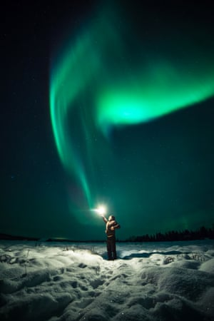 A Young Wizard Casts The Lumos Spell Causing Northern Lights To Appear In