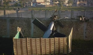 Part of a damaged helicopter is seen lying near the compound where al-Qaeda leader Osama bin Laden was killed in Abbottabad May 2, 2011.