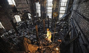 Owen Godbert, a forensic archaeologist, surveys the debris after the fire at Mackintosh's library