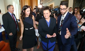 Jacqui Lambie leaves a press conference in the mural hall of Parliament House Canberra this morning, Wednesday 19th November 2014.