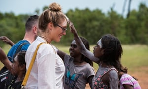 Alice is greeted by a young Yolngu girl.