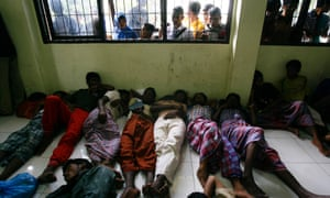 Rohingya refugees sleep on the floor of the immigration office in Lhok Seumawe, northern Aceh, Indonesia, in February 2013. They were part of a group of 120 Rohingya refugees, including six woman and two children, were rescued by fisherman after getting stranded at sea while heading for Australia.
