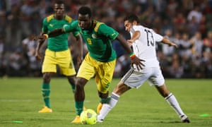 Mame Biram Diouf skips by Sabry Rahel as Senegal beat Egypt to qualify for the 2015 Africa Cup of Nations.
