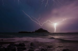 Lightning strikes over St Michael's Mount in Marazion, Cornwall.