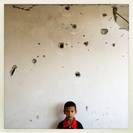 Out of the Phone. 10-year-old Palestinian boy Mohammed Hider Harara poses at his house in Alshjaia, Gaza. @outofthephone