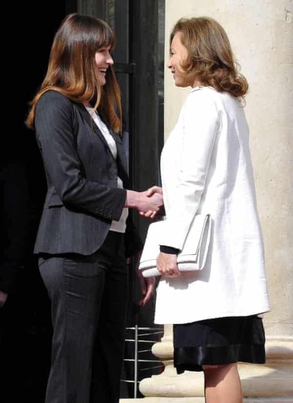 Carla Bruni-Sarkozy greets Valerie Trierweiler