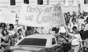 17 April 1985: Anti-apartheid demonstrators march through the traffic on the University of California campus. Students called on the university to cut all business ties with South Africa.