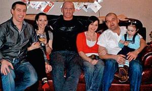 Gareth Thomas on the sofa with his family.