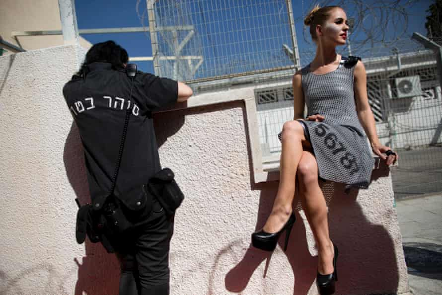 A model waits to walk on a runway before a show in Neve Tirza prison.