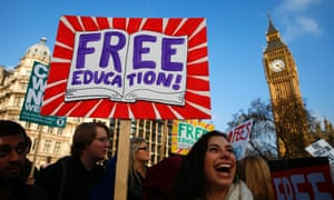 Demonstrators pass the Houses of Parliament as they participate in a protest in favour of free education.