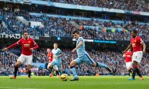 ergio Aguero lines up a shot which David De Gea parries away.
