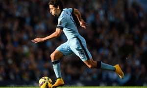 Jesus Navas dribbles down the wing for City.