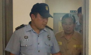 Kim Han-sik, chief executive of Chonghaejin Marine Co, being escorted at Gwangju court.