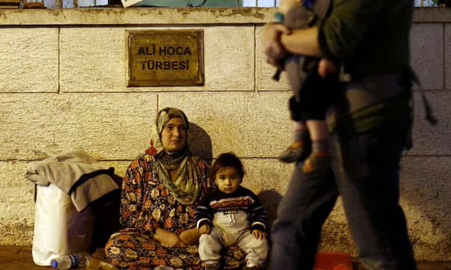 A Syrian refugee begs with her child on the street in Istanbul.
