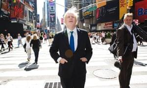Boris Johnson walks around Times Square in New York City.