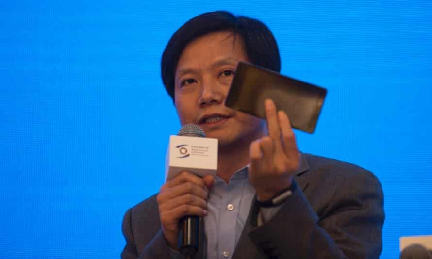 Xiaomi's Lei Jun holding a smartphone