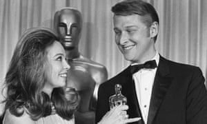 Leslie Caron presents Mike Nichols with his Oscar.