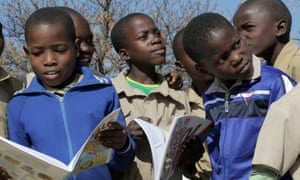 Local children learning about wildlife, Hwange national park, Zimbabwe