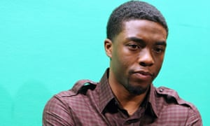 'If we took a break and you sat beside me to eat, you'd be eating with James Brown' ... Boseman. Photograph: Terrence Jennings/Retna