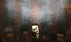Prince Charles looks inside an old bottle kiln during a visit to the Middleport pottery in 2013.