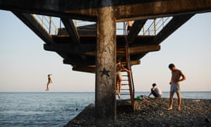 Sukhumi locals on a ruined pier. Pre-war Abkhazia accounted for most of Georgia s coastline and was famous as the Soviet Union's 'Red Riviera'. The subsequent war, international sanctions and a naval blockade devastated the region's economy. Today it is a contrast of natural beauty and ravaged infrastructure
