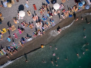 Tourists basking on the pebbled seashore of Gagra. Today some 70% of Abkhazia's state budget comes from Russian handouts, with most of the rest from tourism; a local tourist agent estimated 98% of Abkhazia's tourists are Russian