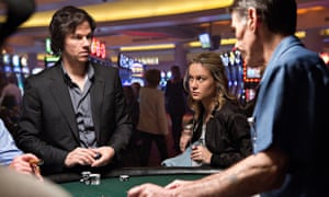 Mark Wahlberg and Brie Larson look tense as the dice are rolled
