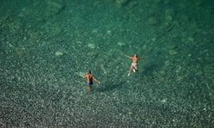 Tourists swim in the sea of Gagra