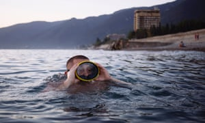 Vladimir Salangin swimming off Gagra beach. The 21-year-old works as a security guard in southern Russia and had seen the sea for the first time the day before this picture was taken