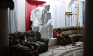 Lenin looms over young Russians on their tablets and iphones in a soviet-era sanitorium in Gagra