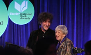 Ursula  Le Guin and Neil Gaiman on stage at the National Book Awards