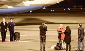A handout picture made available by the US Air Force on 10 November 2014 shows Kenneth Bae (4-R), hugging his mother for the first time in more than two years after returning to the United States on 8 November 2014.