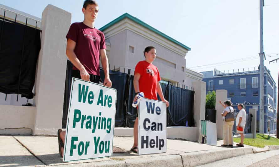 """Anti-abortion advocates stand outside Mississippi's only abortion clinic, singing and praying for their patients, and """"counseling"""" them to reject abortion."""