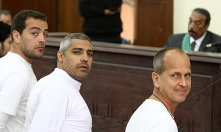 Baher Mohamed, Mohamed Fahmy and Peter Greste during their trial in Cairo.