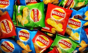 Lots of packets of Walkers cheese and onion, ready salted and salt and vinegar crisps.