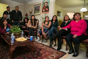 The Vaca and Andrade families watching the president's speech together at the Andrade house in Arlington, Virginia.