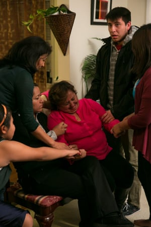 Ingrid Vaca being comforted by friends after watching the president's speech.