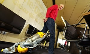 Inventor James Dyson with one of his vacuum cleaners.
