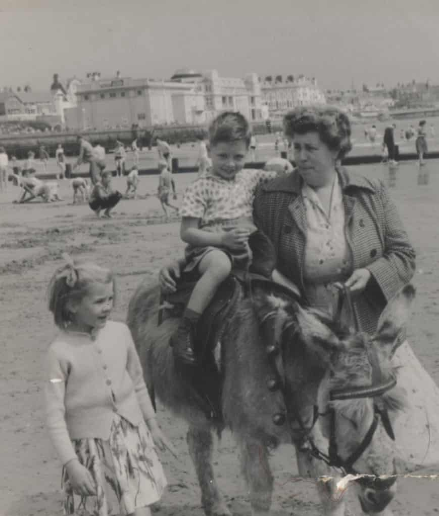 David Hayes rides a donkey on Bridlington beach in 1962, accompanied by his mother and sister.
