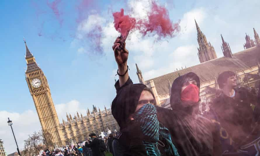 Protesters with flares in Parliament Square.