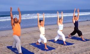 four people doing yoga