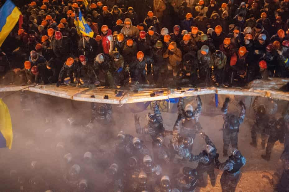 Ukrainian demonstrators clash with riot police officers at Maidan square in Kieve, in December 2013.