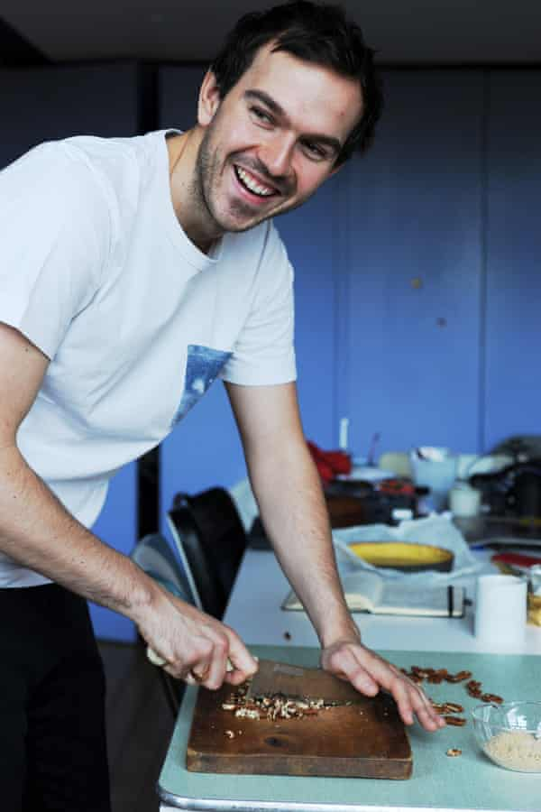 A man chopping nuts.
